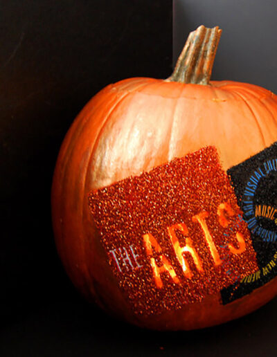 Arts Division logo on a pumpkin for Halloween